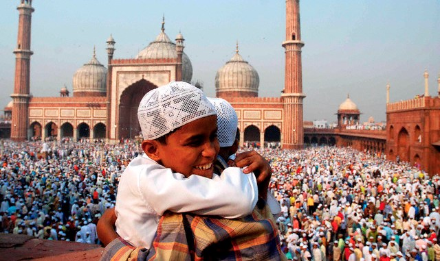 14 Oct 2007, New Delhi, India --- Indian Muslim children greet each other after prayer at Jama Masjid, on the occasion of Eid-al-Fitr in New Delhi. Eid Al Fitr marks the end of Ramadan and the conclusion of month-long fasting.   --- Image by © epa/Corbis